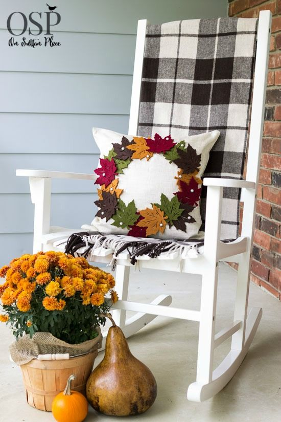 Give your porch or patio a warm touch by adding a cozy pillow. For example, a simple white pillow could be covered with DIY felt leaves in various colors.