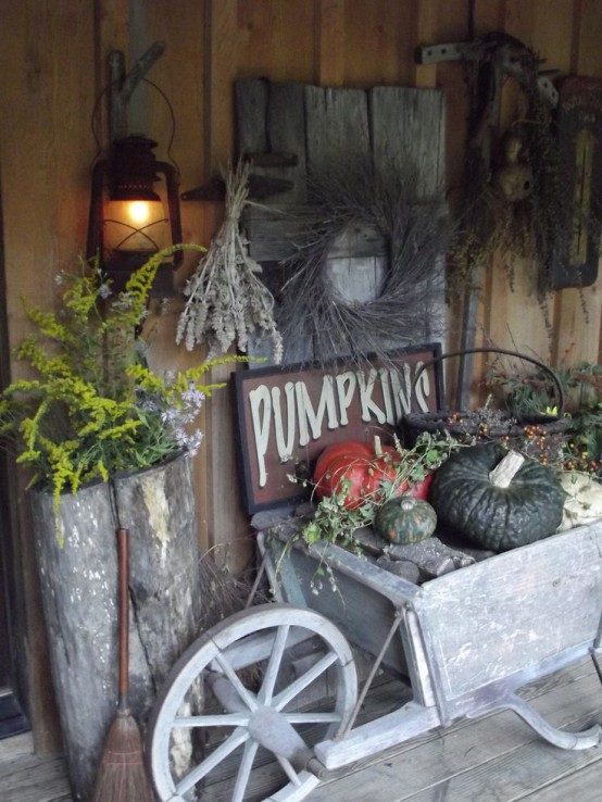 Distressed doors and harvesting tools are great things to use in your fall and Thanksgiving arrangements. What can be more meaningful than such vintage stuff?