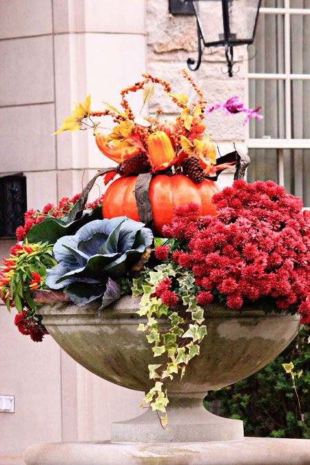 If the space allows put in your planters with fall blooms and other plants small pumpkin centrepieces. This is an easy yet great idea for a seasonal upgrade.
