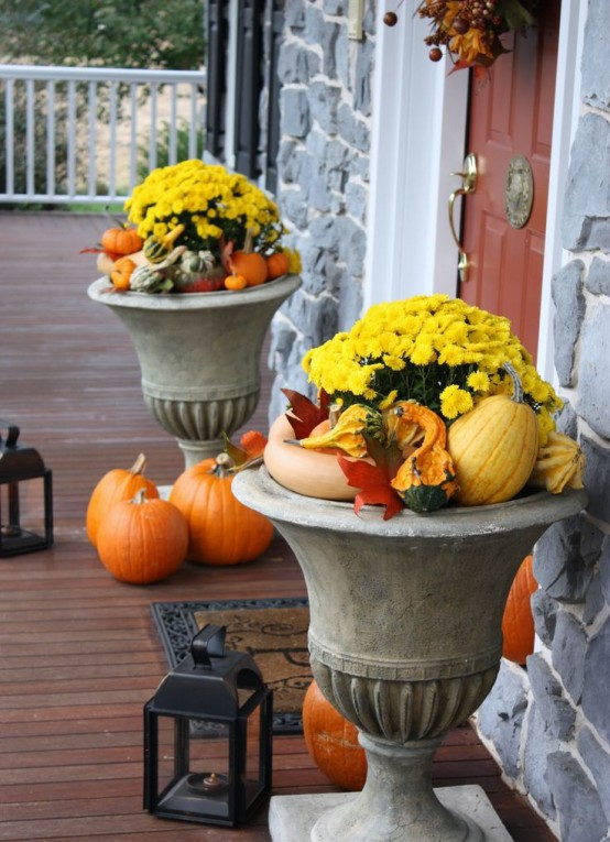 Besides traditional fall blooms you can put small pumpkins and gourds, faux leaves and other products of harvest there. Pumpkins in various colors and sizes make a beautiful fall decoration when piled in a planter and placed on your porch. Use a block of florist's foam to keep all these stuff at the top when your planters are too big.