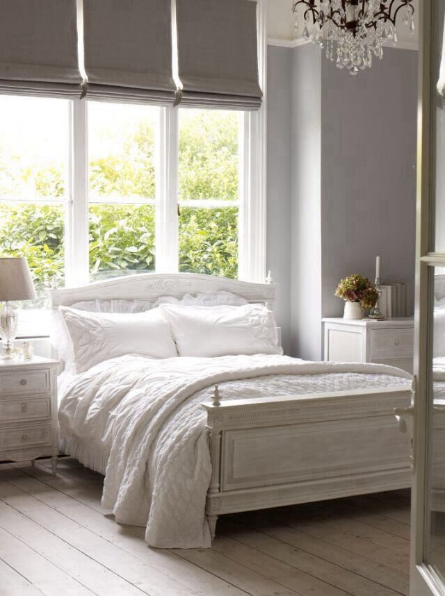 a white shabby chic bedroom with whitewashed floors and furniture is delicate and vintage inspired