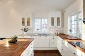 a white kitchen warmed up warm stained butcherblock countertops and add color to the space