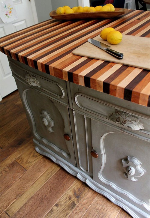 a catchy colorful striped butcherblock counertop make the vintage kitchen island very cool and very interesting