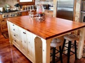rich stained wooden countertops in a neutral kitchen are a great means to warm up the space and make it catchy