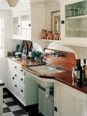 a vintage white kitchen made catchy and interesting with dark wooden countertops looks more dramatic and bold