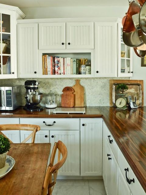 a rich stained wooden kitchen countertop is a timeless idea that brings warmth and coziness to any space