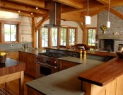 a chalet kitchen done with light and rich stained wood and stone is a stylish space, with ultimate coziness and warmth