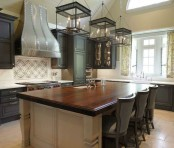 a vintage graphite grey kitchen and a neutral kitchen island with dark stained countertops that add elegance and chic