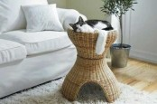 a raised basket cat bed is a fun idea and your cat will love being raised from the floor plus the bed adds a rustic feel to the space