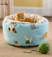 a colorful ottoman-style cat bed of fun printed fabric is always a nice and veyr comfy idea, your cat will soak in it