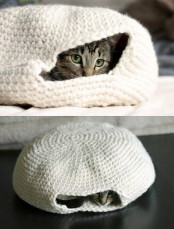 a crochet cave-like cat bed can be DIYed or bought, it's an easy spot to hide from everyone