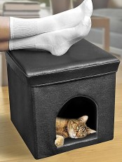 a black leather cube with a cat bed inside is a cool and modern idea with a stylish design and it will match many interiors