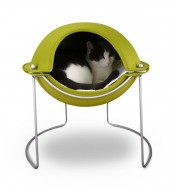 a  neon pod on metal legs is not just a bed, it's a retreat to hide inside, it's bright and cool