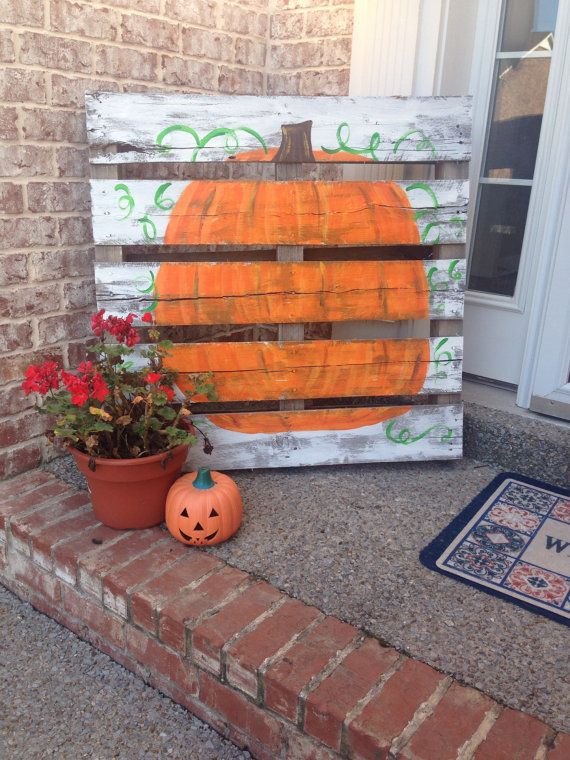 a fall pumpkin sign, a potted flower and a Jack o lantern for decorating your front porch