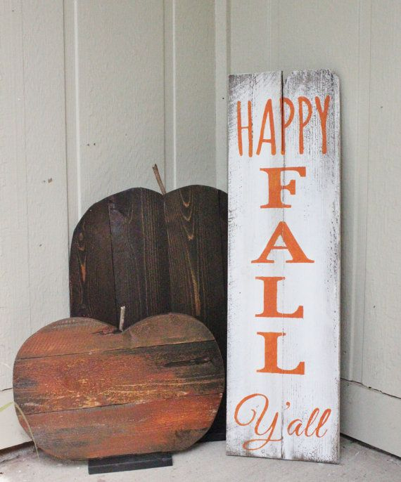 a simple and rustic fall sign and a couple of pumpkins made of plywood for fall decor