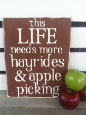 a simple brown and white sign with some apples around is a cool idea for fall decor