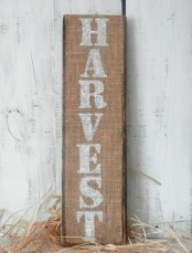 a burlap fall sign with white letters is a pretty rustic option using non-traditional materials