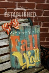 a patina fall sign with colorful letters and a bright ribbon bow to accent it
