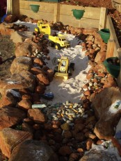 an old pond or fountain space can be transformed into a playground with sand and pebbles – a building or some other one that your kids may need