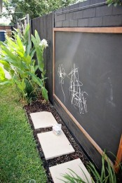 a large chalkboard and colorful chalk will inspire your kids' creativity outdoors, too