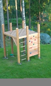 a small kids' play space of wood, with a climbing wall and a ladder is easy to build