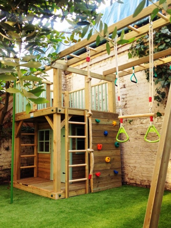 a green lawn, a wooden house, ladders, a climbing wall, various sporty touches for kids having fun here