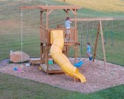 an outdoor playground of wood, with swings, ladders, a slide and other stuff, colorful and fun