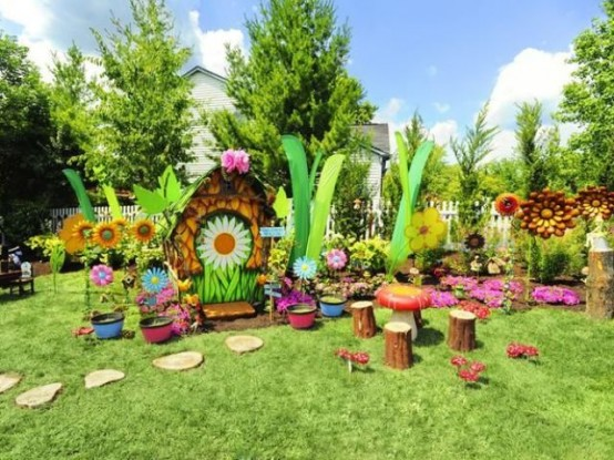 a colorful fairy playground with bright blooms, tree stumps, painted stones and other stuff for fun