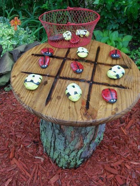 a small tic-tac-toe table with colorful stones is absolutely DIYable and you can make all its parts yourself