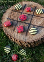 a little tic-tac-toe of a wood slice and colorful bug stones to play it is ideal for outdoors