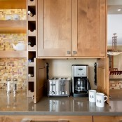 a mini cabinet with a coffee machine and a toaster under an upper cabinet will keep your small kitchen neat and decluttered