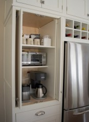 a neutral cabinet hides several appliances, sugar, tea and mugs is a lovely coffee or breakfast station