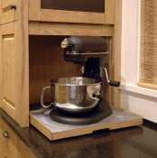 a small cabinet with a retracting shelf and a mixer is a pretty idea to hide your appliance and keep the kitchen neat