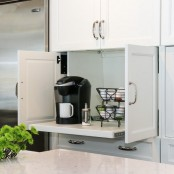 a small cabinet with a retracting shelf hides a whole coffee station, which is very comfy and cool