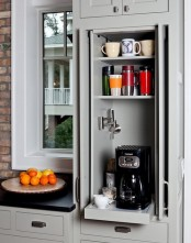 a small cabinet with shelves and a retracting one with a coffee machine is a lovely mini coffee station