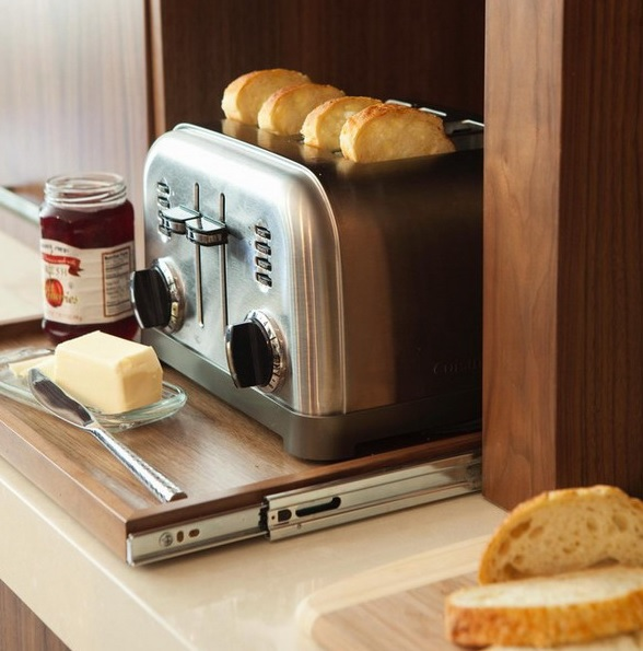 a retractable shelf with a toaster is a pretty idea for those who love toasts for breakfast