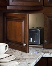 a dark stained cabinet with a toaster is a lovely idea if you use it only for breakfast and don't need in any other time