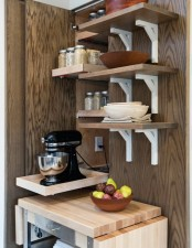 a narrow mini cabinet with a retractable shelf that hides a mixer and spices over it on matching shelves