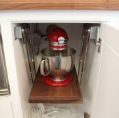 a cabinet with a retractable shelf and a mixer there will keep any eye-sores away