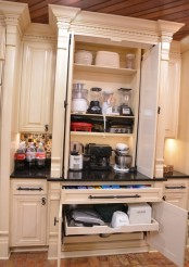 a large cabinet with shelves with appliances and drawers that hold appliances, too is a cool idea for making your kitchen more practical