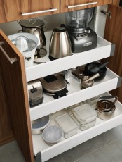 a cabinet with retractable shelves to hold appliances, pots and other stuff is a cool idea to rock