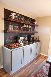 a coffee bar styled with a chalkboard wall for making notes and with rough wooden shelves looks very chic and very cozy