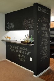a chalkboard kitchen island with an additional wall and light is a cool idea for a modern kitchen and can be integrated into many decor styles