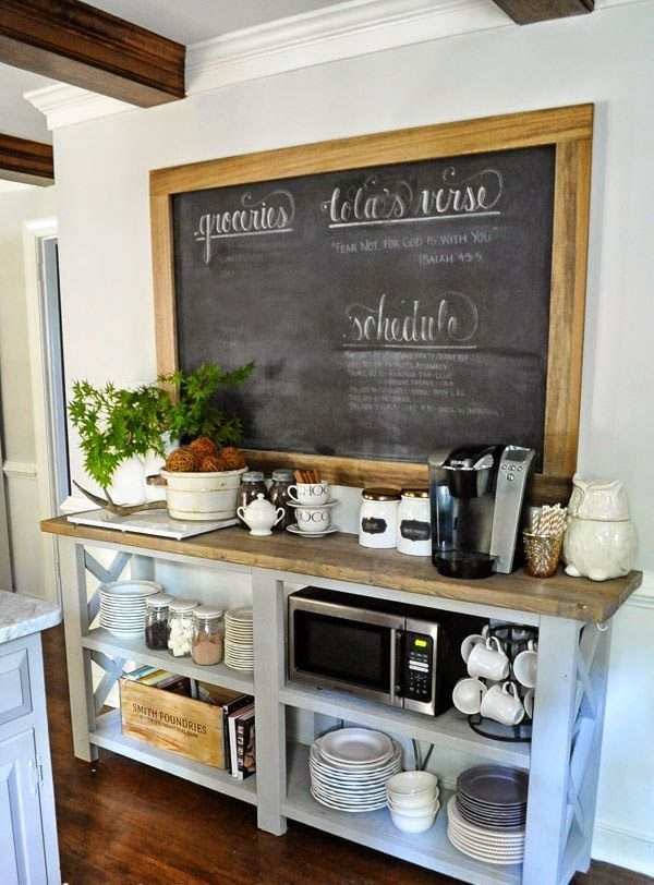 a chalkboard in a frame over a coffee station is a nice idea for a farmhouse space like this kitchen