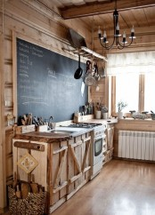 a rustic kitchen of wood, with catchy cabinets, a chalkboard in a frame that acts as a backsplash and as an art