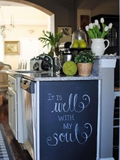 a side of a cabinet with a chalkboard piece that allows leaving notes, menus and other stuff is a great idea to hide it if you need it