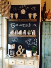 a farmhouse coffee station with wooden shelves, a chalkboard with menus and notes