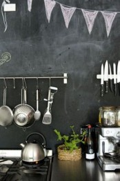 a chalkboard backsplash with railings, holders and chalkboard decor is a very modern and very simple solution to rock