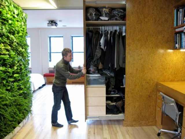 a whole closet hidden in the wall and retracted when needed is a cool idea for small homes   you won't need a separate room