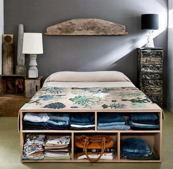 an open storage cabinet that doubles as a bench at the foot of the bed is a smart and easy idea to store some clothes